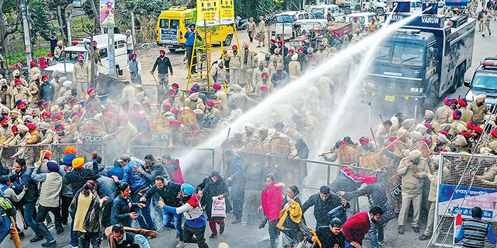 Several protesters injured in Chandigarh after police used water cannons