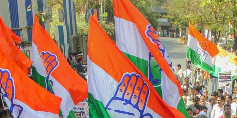 Congress stages sit-in, accuses BJP of making ''false promises'' on Article 370