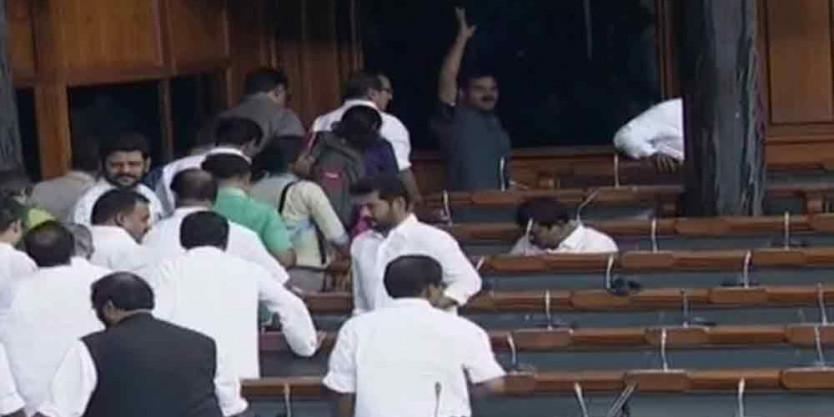 Opposition walks out of Lok Sabha over Karnataka crisis