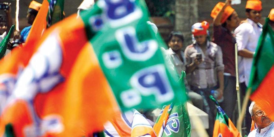 BJP furls its flag on AMTS, violates Model Code of Conduct