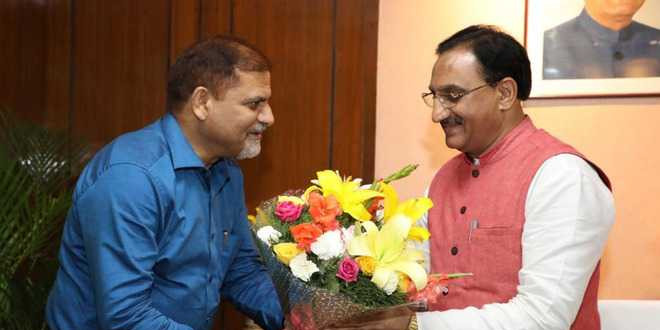 PU VC meets HRD Minister